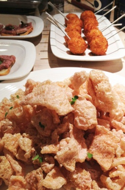 Seared Pig Trotters (pork rinds) dusted with a vinegar powder. And Pimento Cheese Fritters.